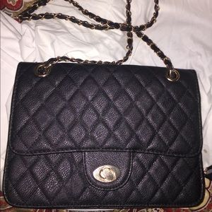 Black crossbody with gold chain.